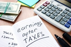 Note with written words Earnings after Taxes.